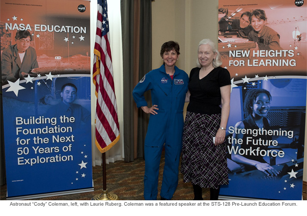 Astronaut Cody Coleman, left, with Laurie Ruberg. Coleman was a featured speaker at the STS-128 Pre-Launch Education Forum.