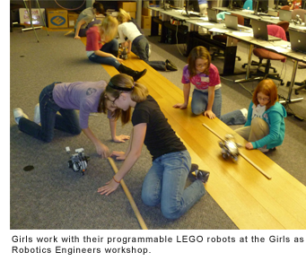 Girls work with their programmable LEGO robots at the Girls as Robotics Engineers workshop.