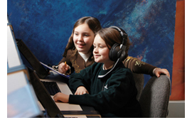 Image of two students working through a live Challenger Learning Center simulation.