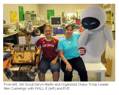 An image of Girl Scout Deryn Martin and Troop Leader Meri Cummings with Wall-E
